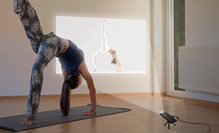 Yoga instruction shown using the projector